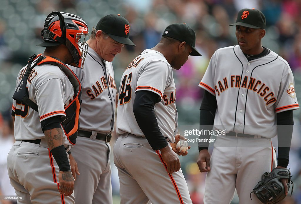 Pitching coach <a gi-track='captionPersonalityLinkClicked' href=/galleries/search?phrase=Dave+Righetti&family=editorial&specificpeople=210835 ng-click='$event.stopPropagation()'>Dave Righetti</a> #33 of the San Francisco Giants visits the mound to talk to relief pitcher <a gi-track='captionPersonalityLinkClicked' href=/galleries/search?phrase=Santiago+Casilla&family=editorial&specificpeople=682637 ng-click='$event.stopPropagation()'>Santiago Casilla</a> #46 of the San Francisco Giants as he works against the Colorado Rockies at Coors Field on April 23, 2014 in Denver, Colorado. Casilla recoreded a blown save as the Giants defeated the Rockies 12-10 in 11 innings.