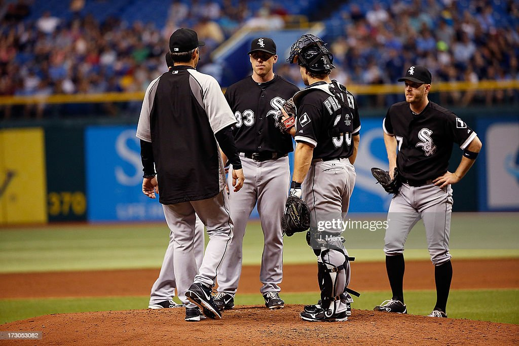 Pitching coach <a gi-track='captionPersonalityLinkClicked' href=/galleries/search?phrase=Don+Cooper&family=editorial&specificpeople=542732 ng-click='$event.stopPropagation()'>Don Cooper</a> #99 of the Chicago White Sox takes out starting pitcher Dylan Axelrod #33 in the second inning against the Tampa Bay Rays during the game at Tropicana Field on July 5, 2013 in St. Petersburg, Florida.