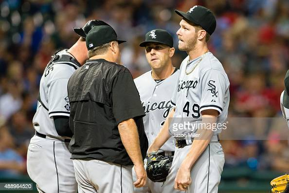 Pitching coach Don Cooper talks with starting pitcher Chris Sale of the Chicago White Sox during the third inning against the Cleveland Indians at...