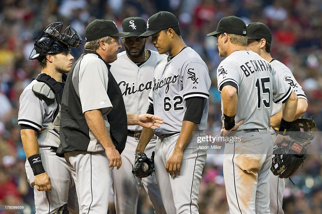 Pitching coach Don Cooper #99 talks with starting pitcher Jose Quintana #62 of the Chicago White Sox during the fifth inning against the Cleveland Indians at Progressive Field on July 31, 2013 in Cleveland, Ohio.