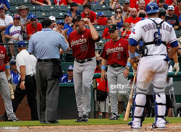 Pitching coach Doug Brocail of the Houston Astros reacts to a call by umpire Dale Scott as manager Brad Mills of the Houston Astros and Yorvit...