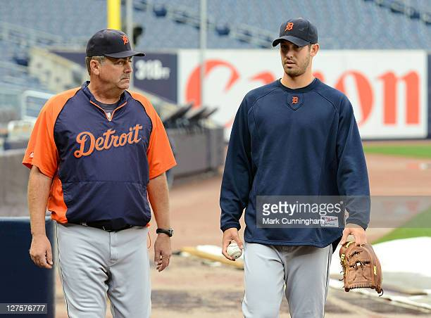 Pitching coach Jeff Jones and Rick Porcello of the Detroit Tigers walk together on the field as the Tigers and New York Yankees prepare for the ALDS...