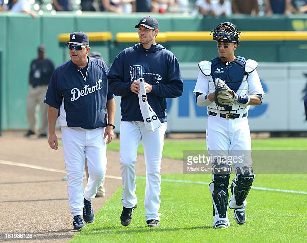 Pitching coach Jeff Jones Doug Fister and Victor Martinez of the Detroit Tigers walk in from the bullpen prior to the game against the Seattle...