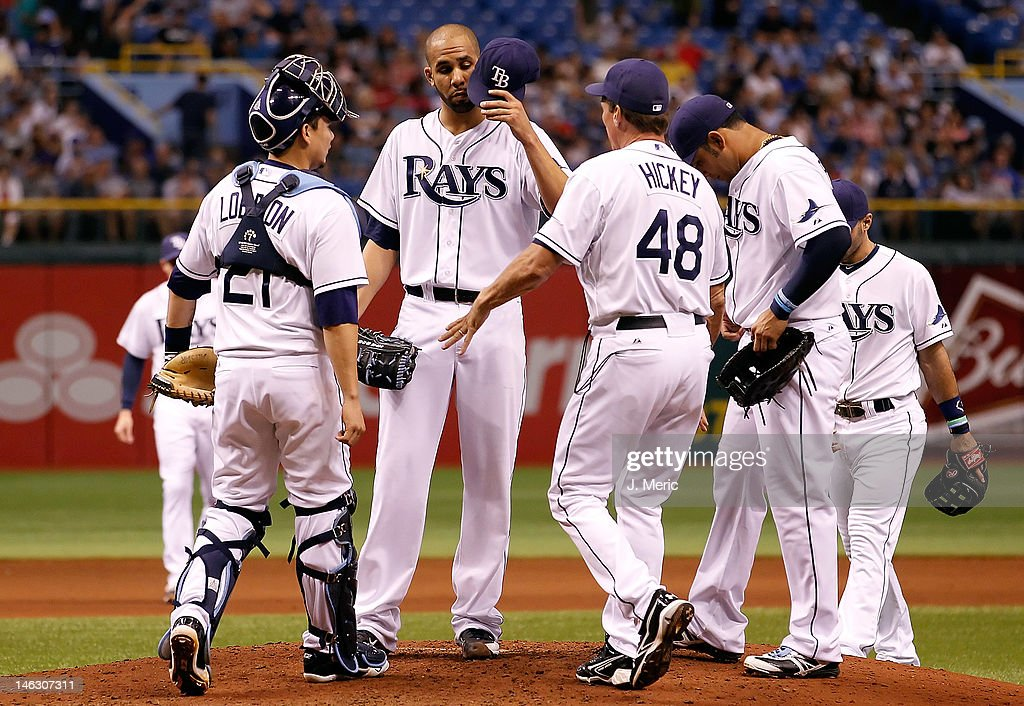 Pitching coach <a gi-track='captionPersonalityLinkClicked' href=/galleries/search?phrase=Jim+Hickey&family=editorial&specificpeople=643232 ng-click='$event.stopPropagation()'>Jim Hickey</a> #48 of the Tampa Bay Rays talks with pitcher <a gi-track='captionPersonalityLinkClicked' href=/galleries/search?phrase=David+Price+-+Baseball+Player&family=editorial&specificpeople=4961936 ng-click='$event.stopPropagation()'>David Price</a> #14 during the game against the New York Mets at Tropicana Field on June 13, 2012 in St. Petersburg, Florida.