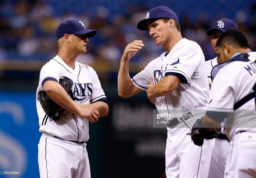 Pitching coach Jim Hickey #48 of the Tampa Bay Rays talks with pitcher Alex Cobb #53 during the game against the New York Yankees at Tropicana Field on September 4, 2012 in St. Petersburg, Florida.