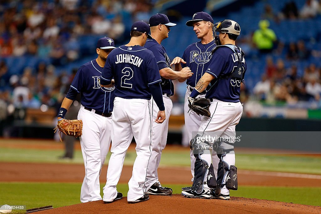 Pitching coach Jim Hickey #48 of the Tampa Bay Rays talks with pitcher Alex Cobb #53 during the game against the Kansas City Royals at Tropicana Field on June 15, 2013 in St. Petersburg, Florida.