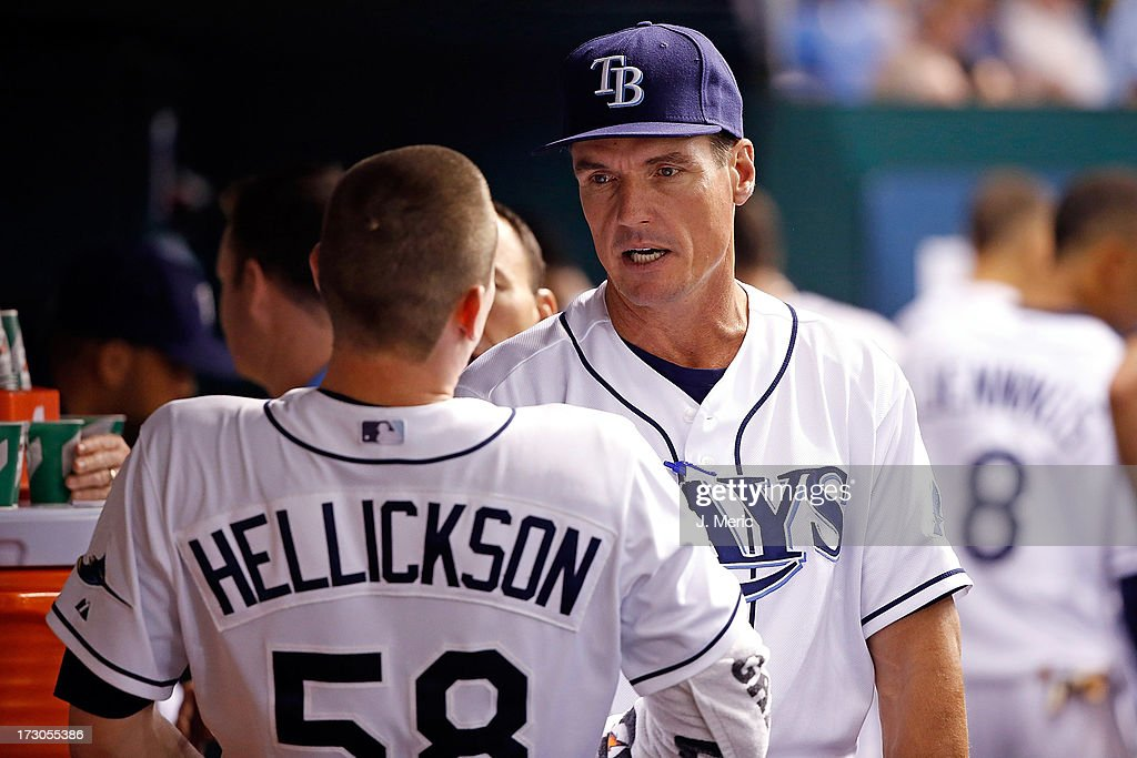 Pitching coach Jim Hickey #48 of the Tampa Bay Rays talks with pitcher Jeremy Hellickson #58 between innings against the Chicago White Sox during the game at Tropicana Field on July 5, 2013 in St. Petersburg, Florida.