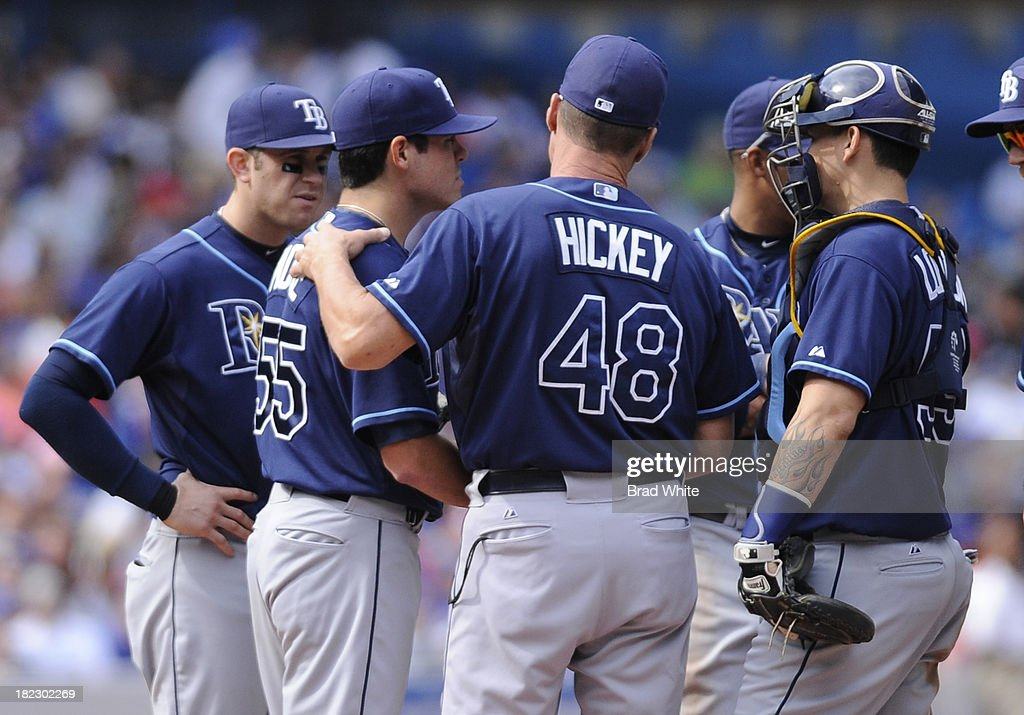 Pitching Coach Jim Hickey of the Tampa Bay Rays talks with pitcher Matt Moore #55 in the first inning during MLB game action against the Toronto Blue Jays September 29, 2013 at Rogers Centre in Toronto, Ontario, Canada.