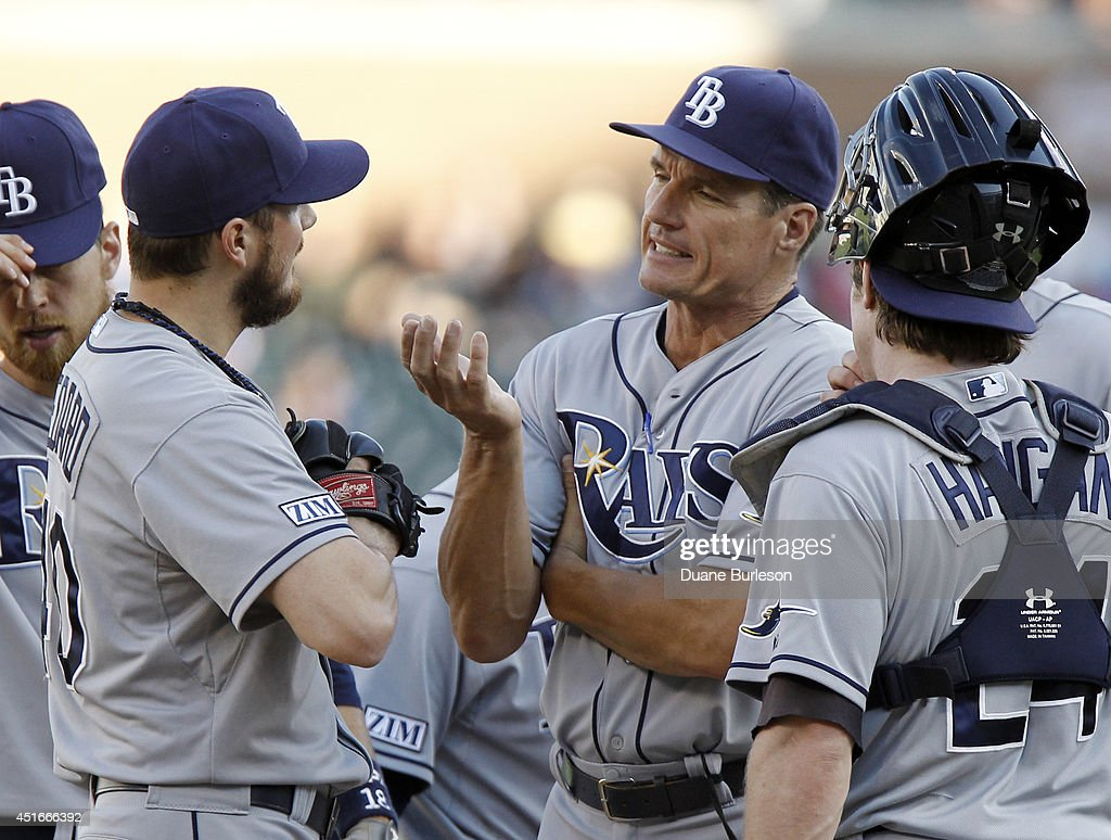 Pitching coach <a gi-track='captionPersonalityLinkClicked' href=/galleries/search?phrase=Jim+Hickey&family=editorial&specificpeople=643232 ng-click='$event.stopPropagation()'>Jim Hickey</a> #48 of the Tampa Bay Rays talks with starting pitcher Erik Bedard #40 of the Tampa Bay Rays during the first inning at Comerica Park on July 3, 2014 in Detroit, Michigan. Bedard gave up six runs and eight hits in two innings, he did not return for the third inning.