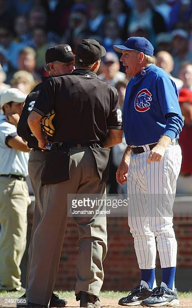 Pitching coach Larry Rothschild of the Chicago Cubs argues with home plate umpire Bill Hohn and crew chief Mike Reilly after being thrown out from a...