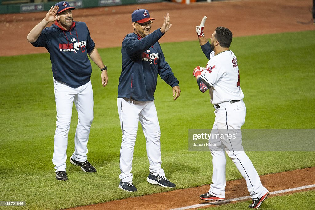 Pitching coach <a gi-track='captionPersonalityLinkClicked' href=/galleries/search?phrase=Mickey+Callaway&family=editorial&specificpeople=3002338 ng-click='$event.stopPropagation()'>Mickey Callaway</a> #32 and manager <a gi-track='captionPersonalityLinkClicked' href=/galleries/search?phrase=Terry+Francona&family=editorial&specificpeople=171936 ng-click='$event.stopPropagation()'>Terry Francona</a> #17 celebrate with <a gi-track='captionPersonalityLinkClicked' href=/galleries/search?phrase=Mike+Aviles&family=editorial&specificpeople=4944765 ng-click='$event.stopPropagation()'>Mike Aviles</a> #4 of the Cleveland Indians after Aviles hit a walk-off single to defeat the Minnesota Twins at Progressive Field on May 7, 2014 in Cleveland, Ohio. The Indians defeated the Twins 4-3.