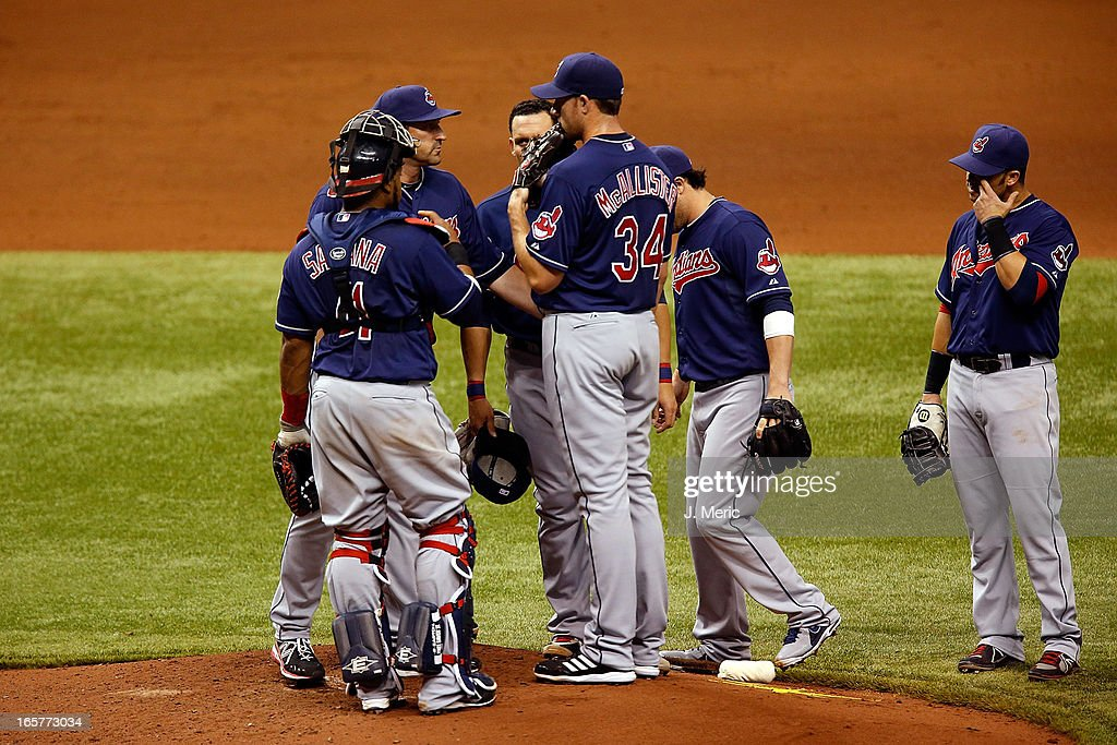 Pitching coach <a gi-track='captionPersonalityLinkClicked' href=/galleries/search?phrase=Mickey+Callaway&family=editorial&specificpeople=3002338 ng-click='$event.stopPropagation()'>Mickey Callaway</a> #44 of the Cleveland Indians talks with pitcher <a gi-track='captionPersonalityLinkClicked' href=/galleries/search?phrase=Zach+McAllister&family=editorial&specificpeople=6816291 ng-click='$event.stopPropagation()'>Zach McAllister</a> #34 during the game against the Tampa Bay Rays at Tropicana Field on April 5, 2013 in St. Petersburg, Florida.