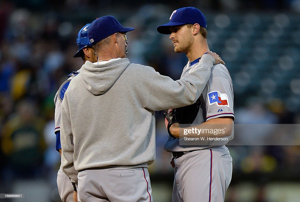 Pitching coach <a gi-track='captionPersonalityLinkClicked' href=/galleries/search?phrase=Mike+Maddux&family=editorial&specificpeople=556746 ng-click='$event.stopPropagation()'>Mike Maddux</a> #31 of the Texas Rangers comes out to talk with pitcher <a gi-track='captionPersonalityLinkClicked' href=/galleries/search?phrase=Justin+Grimm&family=editorial&specificpeople=9480126 ng-click='$event.stopPropagation()'>Justin Grimm</a> #51 after Grimm gave up back to back solo home runs to Yoenis Cespedes #52 and Brandon Moss #37 of the Oakland Athletics (not pictured) in the third inning at O.co Coliseum on May 13, 2013 in Oakland, California.