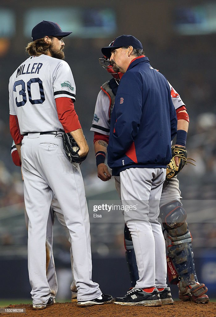Pitching coach Randy Niemann #68 of the Boston Red Sox talks with <a gi-track='captionPersonalityLinkClicked' href=/galleries/search?phrase=Andrew+Miller+-+Baseball+Player&family=editorial&specificpeople=4496823 ng-click='$event.stopPropagation()'>Andrew Miller</a> #30 in the bottom of the 12 inning against the New York Yankees on October 2, 2012 at Yankee Stadium in the Bronx borough of New York City.