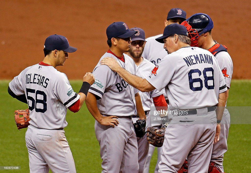 Pitching coach Randy Niemann #68 of the Boston Red Sox talks with pitcher <a gi-track='captionPersonalityLinkClicked' href=/galleries/search?phrase=Daisuke+Matsuzaka&family=editorial&specificpeople=797706 ng-click='$event.stopPropagation()'>Daisuke Matsuzaka</a> #18 during the game against the Tampa Bay Rays at Tropicana Field on September 19, 2012 in St. Petersburg, Florida.