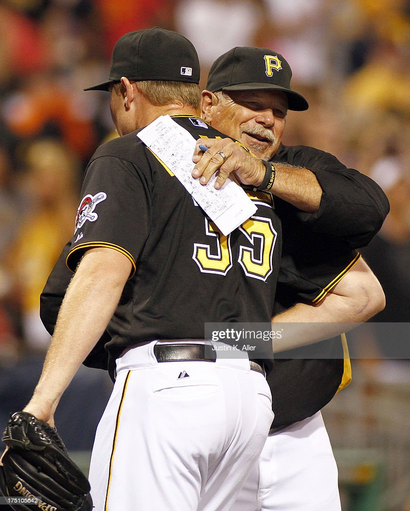 Pitching coach Ray Searage #54 of the Pittsburgh Pirates celebrates with <a gi-track='captionPersonalityLinkClicked' href=/galleries/search?phrase=Mark+Melancon&family=editorial&specificpeople=4900198 ng-click='$event.stopPropagation()'>Mark Melancon</a> #35 after closing out the game on July 31, 2013 at PNC Park in Pittsburgh, Pennsylvania. The Pirates defeated the Cardinals 5-4.
