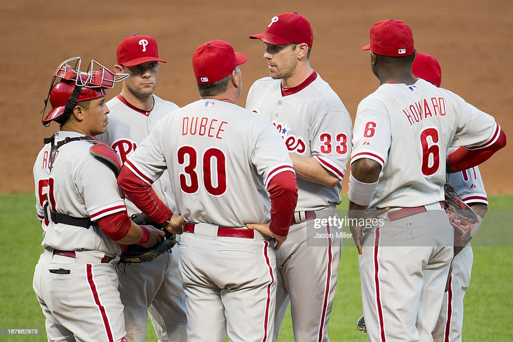 Pitching coach Rich Dubee #30 talks with starting pitcher <a gi-track='captionPersonalityLinkClicked' href=/galleries/search?phrase=Cliff+Lee&family=editorial&specificpeople=218092 ng-click='$event.stopPropagation()'>Cliff Lee</a> #33 of the Philadelphia Phillies during the third inning against the Cleveland Indians at Progressive Field on May 1, 2013 in Cleveland, Ohio.