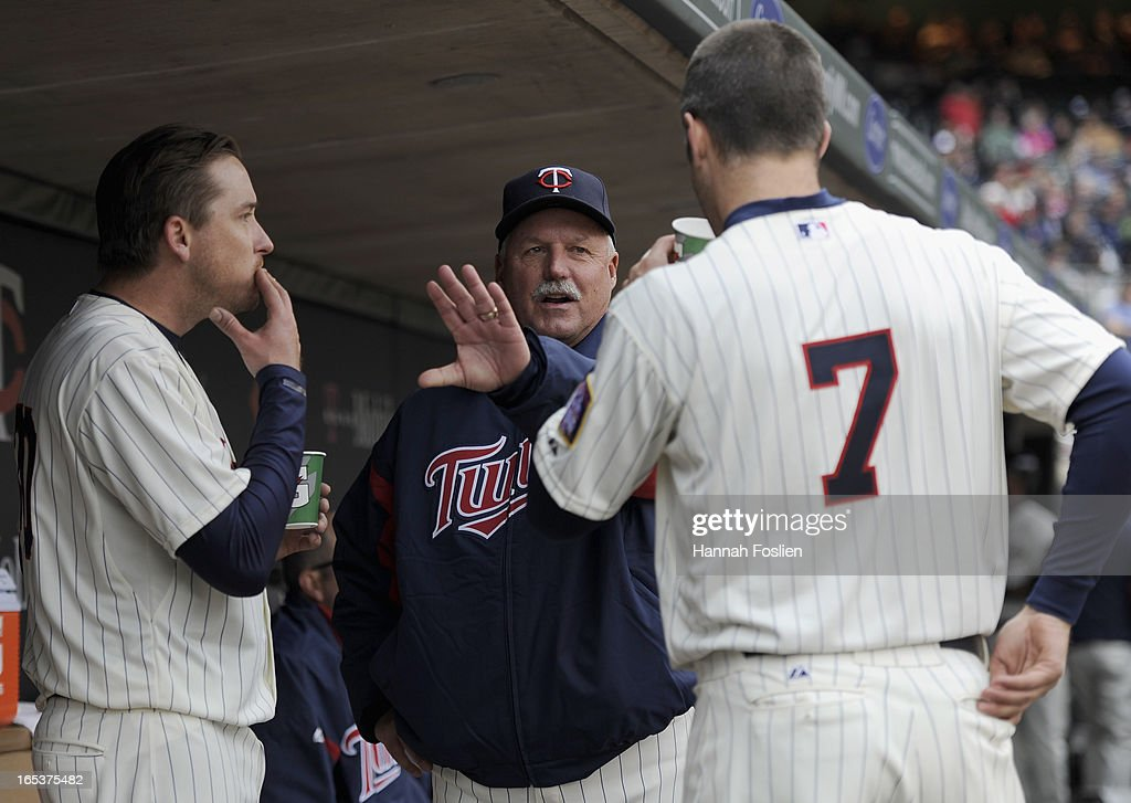 Pitching coach Rick Anderson #40 of the Minnesota Twins (C) speaks with Kevin Correia #30 and Joe Mauer #7 during the fifth inning of the game against the Detroit Tigers on April 3, 2013 at Target Field in Minneapolis, Minnesota.
