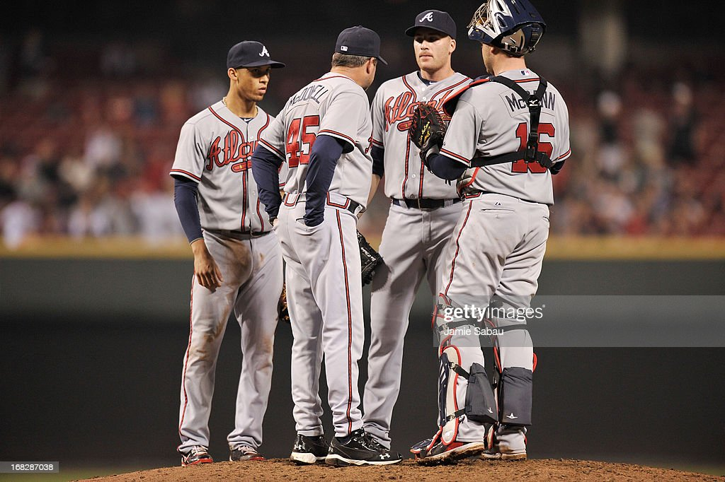 Pitching coach Roger McDowell #45 of the Atlanta Braves talks with pitcher <a gi-track='captionPersonalityLinkClicked' href=/galleries/search?phrase=Eric+O%27Flaherty&family=editorial&specificpeople=2191782 ng-click='$event.stopPropagation()'>Eric O'Flaherty</a> #34 of the Atlanta Braves on the mound in the eighth inning against the Cincinnati Reds at Great American Ball Park on May 7, 2013 in Cincinnati, Ohio. Cincinnati defeated Atlanta 5-4.
