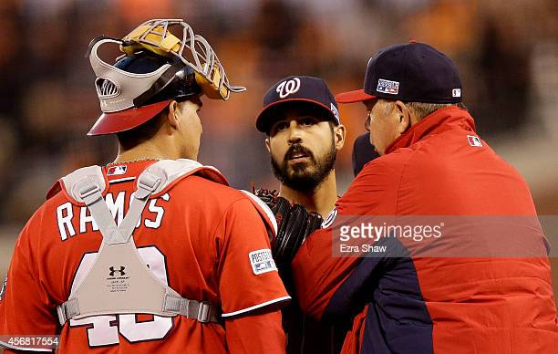 Pitching coach Steve McCatty talks to Gio Gonzalez of the Washington Nationals on the mound in the second inning against the San Francisco Giants...