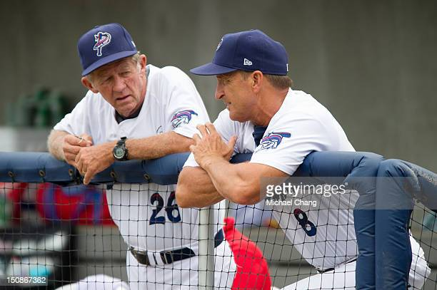 Pitching coach Tom Brown of the Pensacola Blue Wahoos talks with manager Jim Riggleman of the Pensacola Blue Wahoos while playing against the...