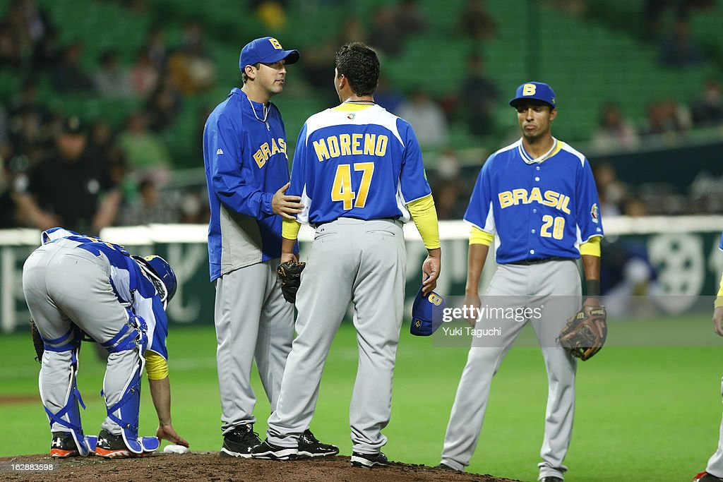 Pitching coachTiago Caldeira #23 of Team Brazil visits the mound during the World Baseball Classic exhibition game against the SoftBank Hawks at the Fukuoka Yahoo! Japan Dome on Thursday, February 28, 2013 in Fukuoka, Japan.
