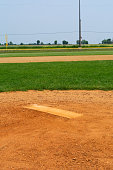 Youth baseball pitching mound on a beautiful Spring day.  LaSalle, Illinois, USA
