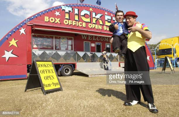 Pitchu a circus entertainer with the Cottle and Austen Circus and thought to be the world's smallest man stands with his friend Tito outside the big...