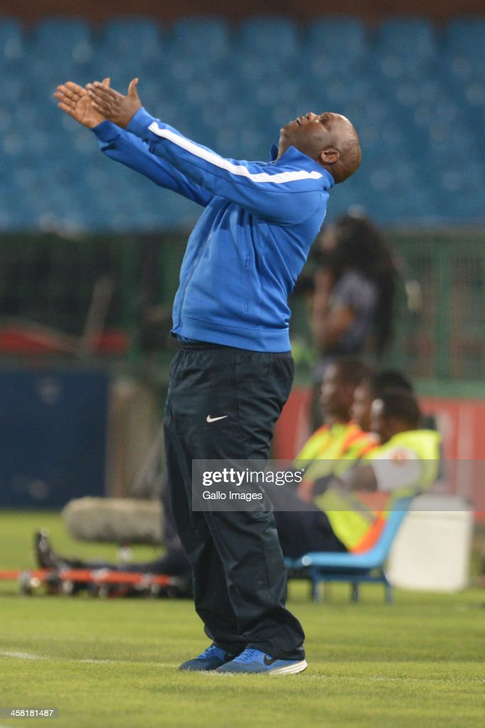 Pitso Mosimane of Mamelodi Sundowns reacts during the Absa Premiership match between Mamelodi Sundowns and Maritzburg United at Loftus Stadium on December 20, 2013 in Pretoria, South Africa.