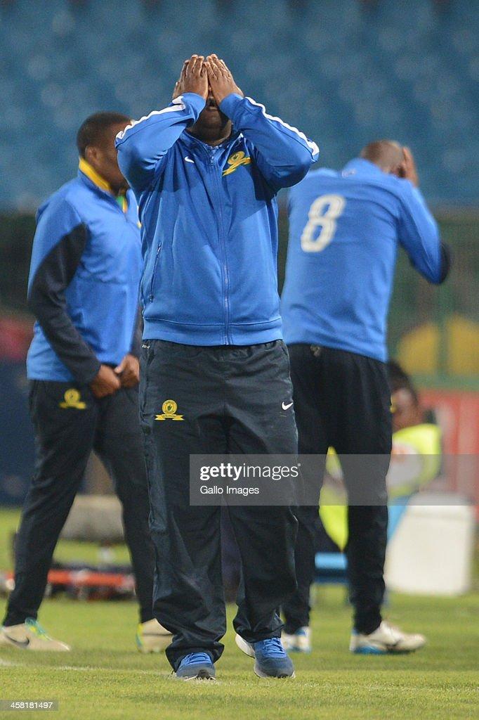 Pitso Mosimane of Mamelodi Sundowns reacts during the Absa Premiership match between Mamelodi Sundowns and Maritzburg United at Loftus Stadium on December 20, 2013 in Pretoria, South Africa.