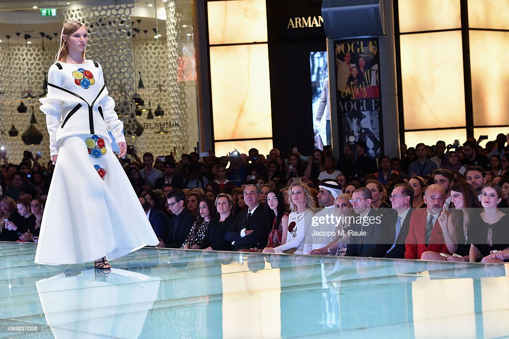 CEO Pitti Immagine Raffaello Napoleone, Ceo of Yoox Stefano Marchetti, guest, Fendi designer Silvia Venturini Fendi, President of Camera Moda and CEO of Costume National Carlo Capasa, <a gi-track='captionPersonalityLinkClicked' href=/galleries/search?phrase=Mariacarla+Boscono&family=editorial&specificpeople=614984 ng-click='$event.stopPropagation()'>Mariacarla Boscono</a>, <a gi-track='captionPersonalityLinkClicked' href=/galleries/search?phrase=Eva+Herzigova&family=editorial&specificpeople=156428 ng-click='$event.stopPropagation()'>Eva Herzigova</a>, Nasser Rafi, Editor-in Chief of Vogue Italia <a gi-track='captionPersonalityLinkClicked' href=/galleries/search?phrase=Franca+Sozzani&family=editorial&specificpeople=639425 ng-click='$event.stopPropagation()'>Franca Sozzani</a>, Chief Executive Officer and Chairman of Conde Nast International <a gi-track='captionPersonalityLinkClicked' href=/galleries/search?phrase=Jonathan+Newhouse&family=editorial&specificpeople=651394 ng-click='$event.stopPropagation()'>Jonathan Newhouse</a> and Managing Director of Conde Nast Italy Giampaolo Grandi, Designer <a gi-track='captionPersonalityLinkClicked' href=/galleries/search?phrase=Christian+Louboutin+-+Fashion+Designer&family=editorial&specificpeople=4644509 ng-click='$event.stopPropagation()'>Christian Louboutin</a>, Bianca Brandolini D'Adda, <a gi-track='captionPersonalityLinkClicked' href=/galleries/search?phrase=Eugenie+Niarchos&family=editorial&specificpeople=2121459 ng-click='$event.stopPropagation()'>Eugenie Niarchos</a> and Malgosia Bela attend the Talents Fashion show during the Vogue Fashion Dubai Experience 2015 at The Dubai Mall on October 29, 2015 in Dubai, United Arab Emirates.