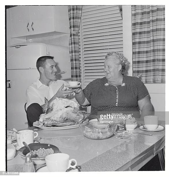 A big cigar and some of his mother's coffee after a big meal finish a 'perfect day' for Pirate second baseman Bill Mazeroski at a family 'victory...