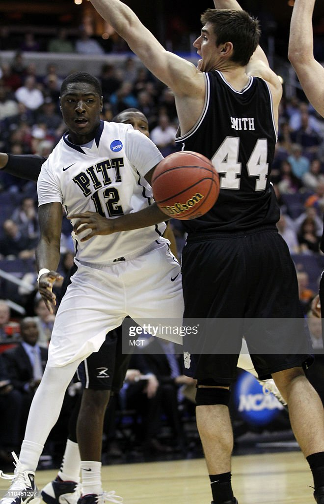 Pittsburgh guard Ashton Gibbs dishes off the ball around Butler center Andrew Smith during firsthalf action in the third round of the 2011 NCAA Men's...