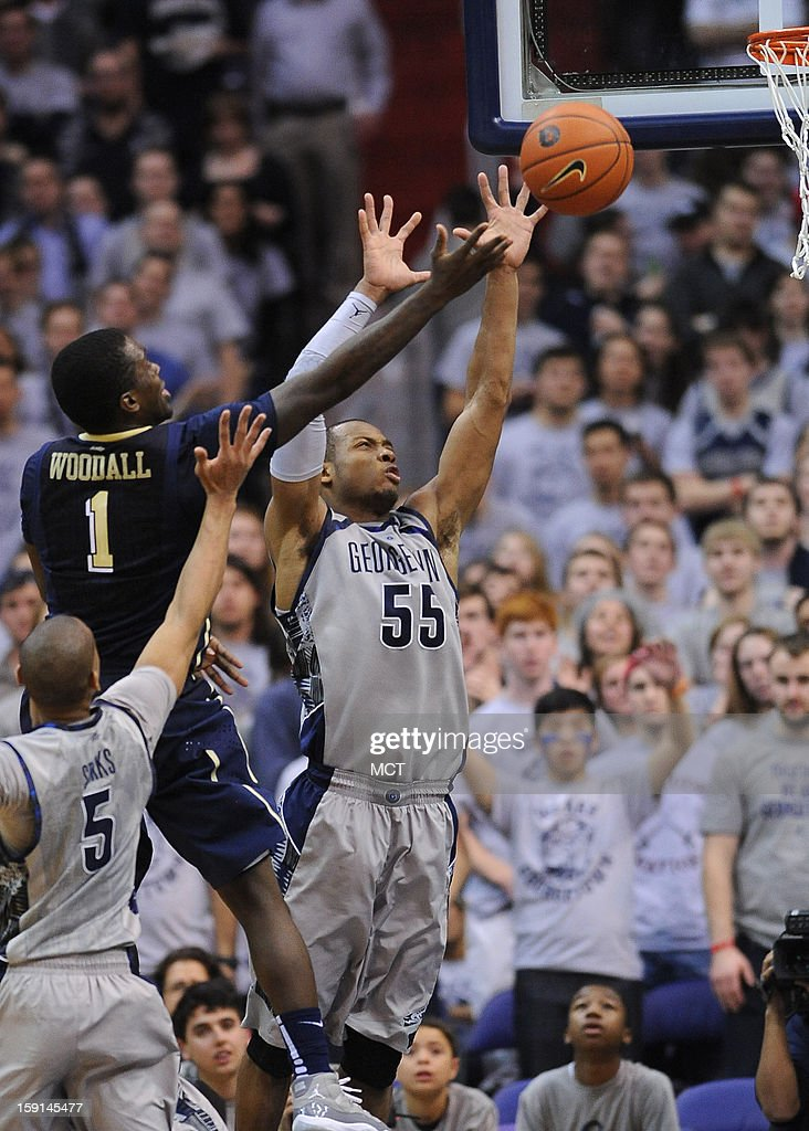 Pittsburgh guard Tray Woodall (1) scores over Georgetown guard Jabril Trawick (55) and Georgetown guard Markel Starks (5) during second-half action at the Verizon Center in Washington, D.C., Tuesday, January 8, 2013. Pitt beat Georgetown, 73-45.