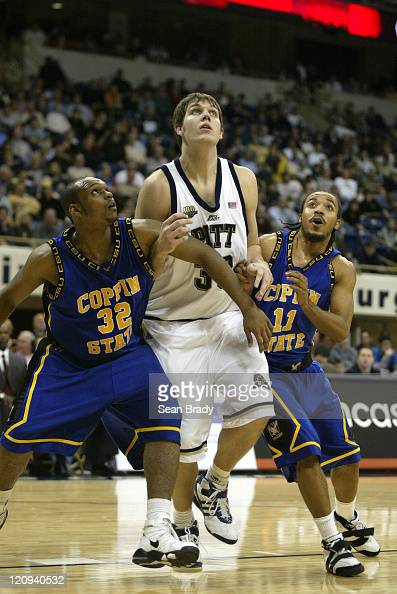 Pittsburgh Panthers Aaron Gray battles for position against Coppin States Darryl Proctor and West Otis during action at the Petersen Events Center on...