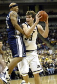 Pittsburgh Panthers' Aaron Gray drives on Notre Dame's Rick Cornett in action at the Petersen Events Center on January 4 2006 in Pittsburgh...