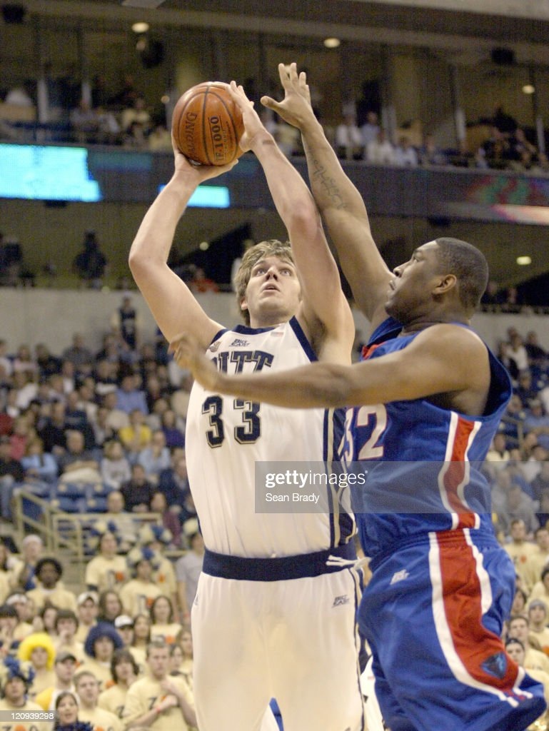Pittsburgh Panthers Aaron Gray shoots over DePaul's Lorenzon Thompson during action at the Petersen Events Center on January 12 2006 in Pittsburgh...
