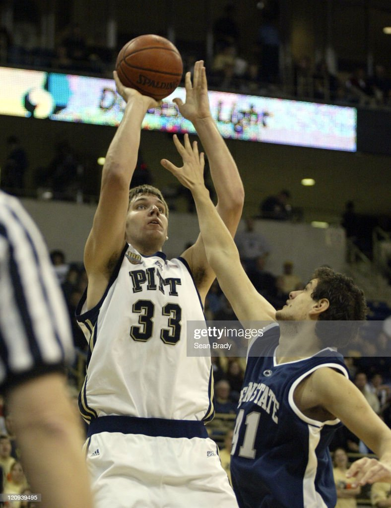 Pittsburgh Panthers' Aaron Gray shoots over Penn States' Milos Bogetic Pittsburgh won the contest 9154 at the Petersen Events Center on December 10...