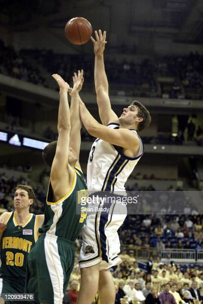 Pittsburgh Panthers Aaron Gray shoots over Vermont's Chris Holm at the Petersen Events Center in Pittsburgh Pennsylvania Dec 17 2005