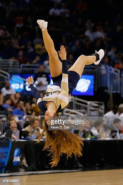 Pittsburgh Panthers cheerleader flips during a break in the game against the Colorado Buffaloes in the second round of the 2014 NCAA Men's Basketball...