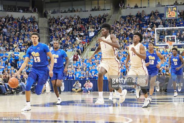 Pittsburgh Panthers guard Cameron Johnson brings the ball up court during a basketball game between Pittsburgh Panthers and Florida State Seminoles...