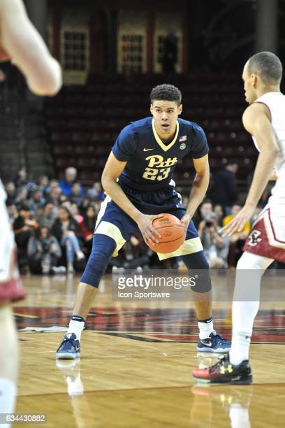 Pittsburgh Panthers guard Cameron Johnson passes the ball off to an open teammate During the Pittsburgh Panthers game against the Boston College...