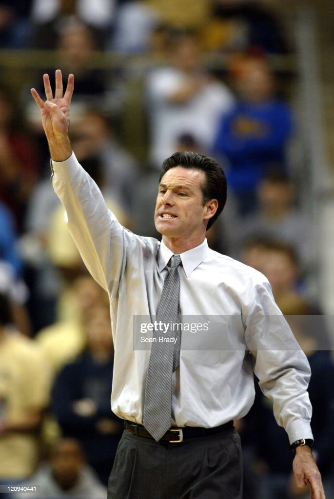 Pittsburgh Panthers' head coach <a gi-track='captionPersonalityLinkClicked' href=/galleries/search?phrase=Jamie+Dixon&family=editorial&specificpeople=234974 ng-click='$event.stopPropagation()'>Jamie Dixon</a> calls out a play versus Duquesne at the Petersen Events Center on December 4, 2004 in Pittsburgh, Pennsylvania.
