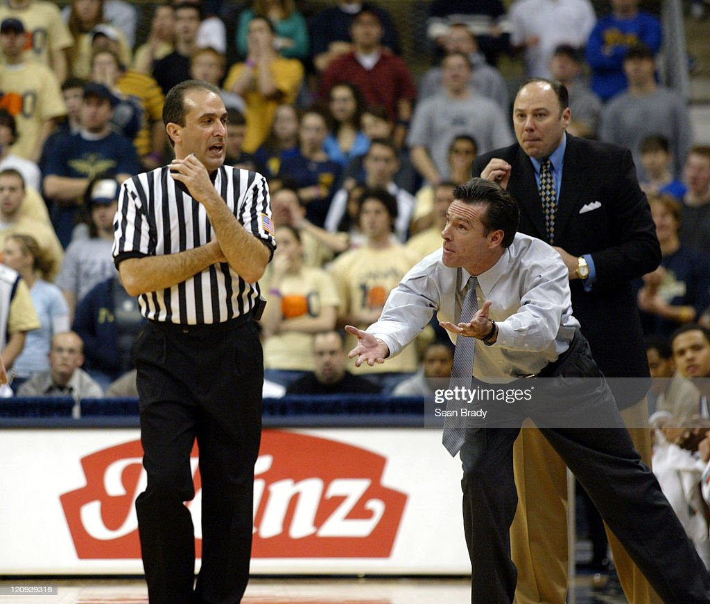 Pittsburgh Panthers' Head Coach <a gi-track='captionPersonalityLinkClicked' href=/galleries/search?phrase=Jamie+Dixon&family=editorial&specificpeople=234974 ng-click='$event.stopPropagation()'>Jamie Dixon</a> disputes a call during play against the Duquesne Dukes at the Petersen Events Center on December 4, 2004 in Pittsburgh, Pennsylvania.