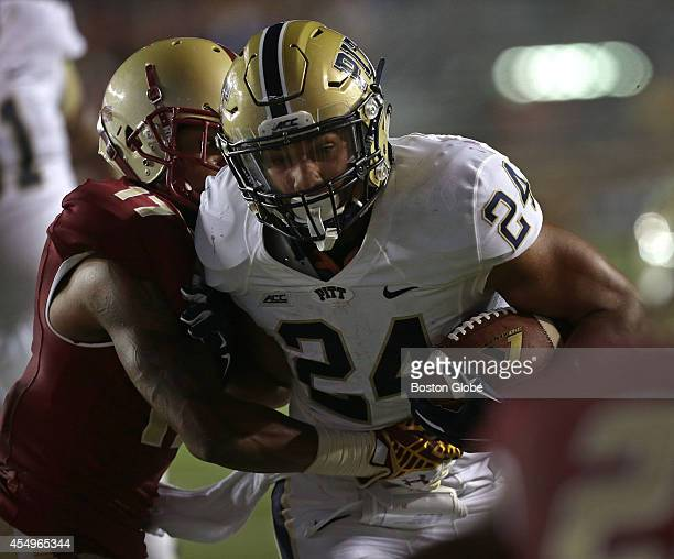 Pittsburgh Panthers running back James Conner fends off Boston College Eagles defensive back Bryce Jones as he carries for a Panthers touchdown in...