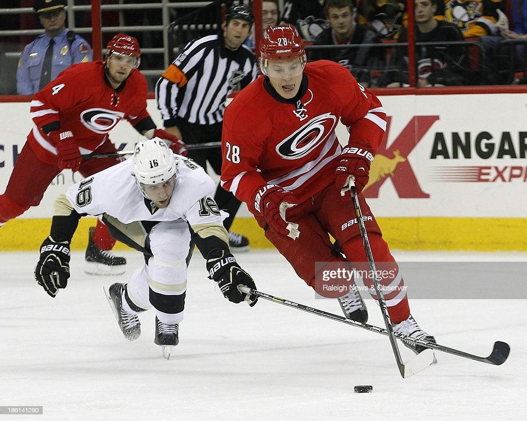 Pittsburgh Penguins' Brandon Sutter (16) tips Carolina Hurricanes' Alexander Semin (28) during the first period at the PNC Arena in Raleigh, North Carolina, on Monday, October 28, 2013.