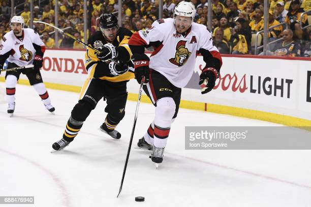 Pittsburgh Penguins Center Evgeni Malkin and Ottawa Senators defenseman Dion Phaneuf battle for the puck during the second period in Game Seven of...