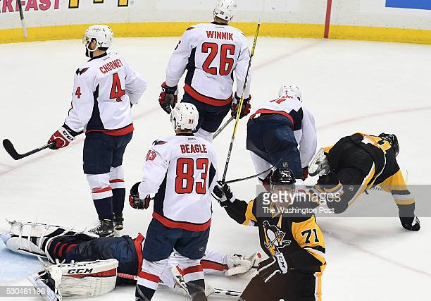 Pittsburgh Penguins center Evgeni Malkin celebrates after Pittsburgh Penguins right wing Phil Kessel diving right scored during the second period of...