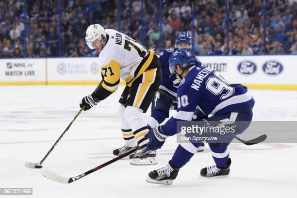 Pittsburgh Penguins center Evgeni Malkin is defended by Tampa Bay Lightning center Vladislav Namestnikov and Tampa Bay Lightning right wing Nikita...