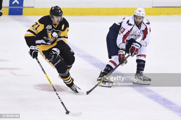 Pittsburgh Penguins Center Evgeni Malkin skates the puck around Washington Capitals right wing Tom Wilson during the first period in Game Four of the...
